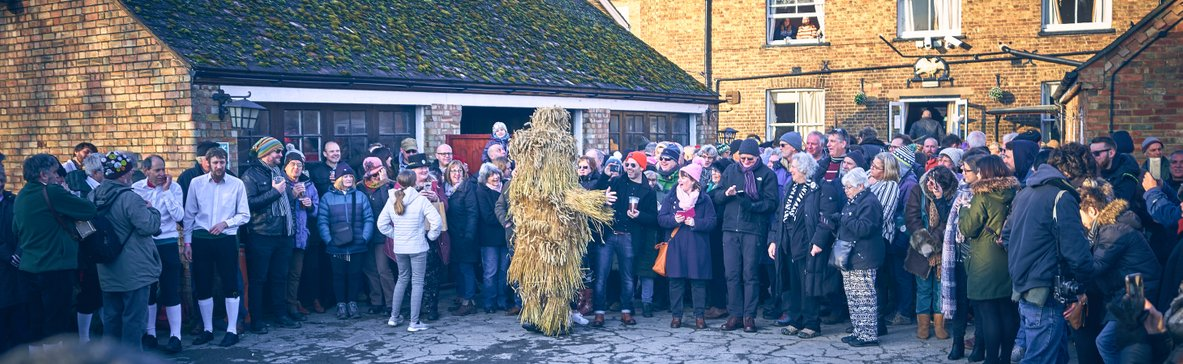 Photographer Ben Potton Straw Bear entertaining crowds at the Falcon